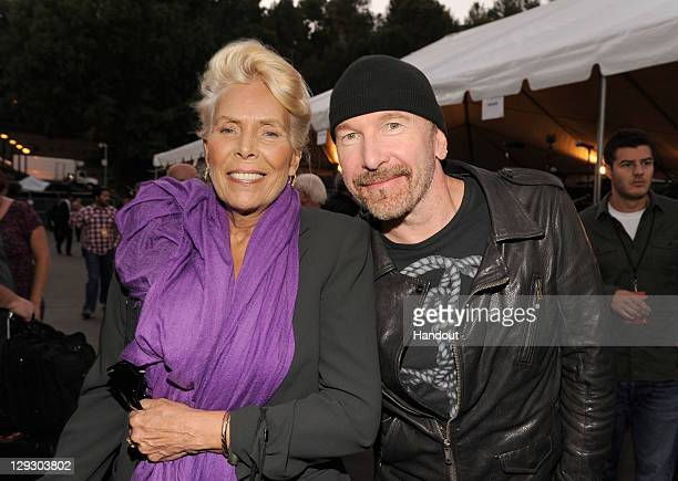 "In this handout image provided by Getty Images musicians Joni Mitchell and The Edge attend ""A Decade of Difference A Concert Celebrating 10 Years of..."