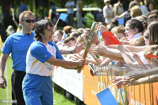 In this handout image provided by Glasgow 2014 Ltd Batonbearer 038 Jane Sargent carries the Glasgow 2014 Queen's Baton through Melrose in the...
