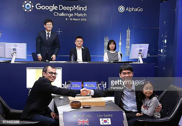 In this handout image provided by Google Google Deepmind head Demis Hassabis shakes hands with South Korean professional Go player Lee SeDol before...
