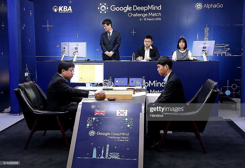 In this handout image provided by Google, South Korean professional Go player Lee Se-Dol (R) waits after putting the first stone against Google's artificial intelligence program, AlphaGo, during the Google DeepMind Challenge Match on March 9, 2016 in Seoul, South Korea. Lee Se-dol played a five-game match against a computer program developed by a Google, AlphaGo.