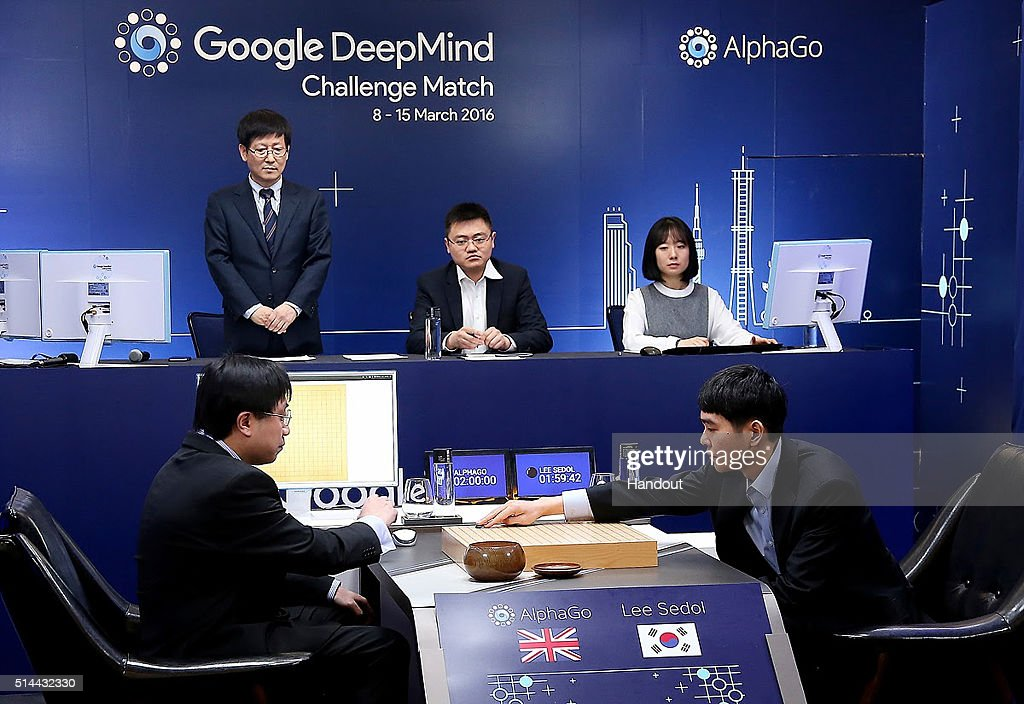 In this handout image provided by Google, South Korean professional Go player Lee Se-Dol (R) puts the first stone against Google's artificial intelligence program, AlphaGo, during the Google DeepMind Challenge Match on March 9, 2016 in Seoul, South Korea. Lee Se-dol played a five-game match against a computer program developed by a Google, AlphaGo.