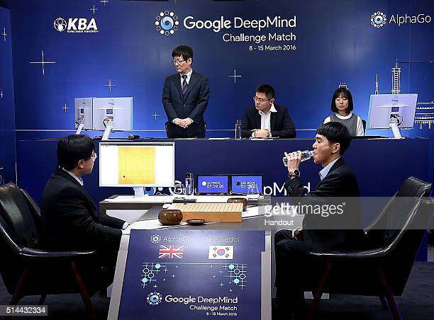 In this handout image provided by Google South Korean professional Go player Lee SeDol drinks after putting the first stone against Google's...