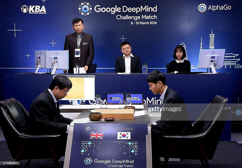 In this handout image provided by Google, South Korean professional Go player Lee Se-Dol (R) prepares for his match against Google's artificial intelligence program, AlphaGo, during the Google DeepMind Challenge Match on March 10, 2016 in Seoul, South Korea. Lee Se-dol is playing a five-match series against a computer program developed by a Google, AlphaGo.