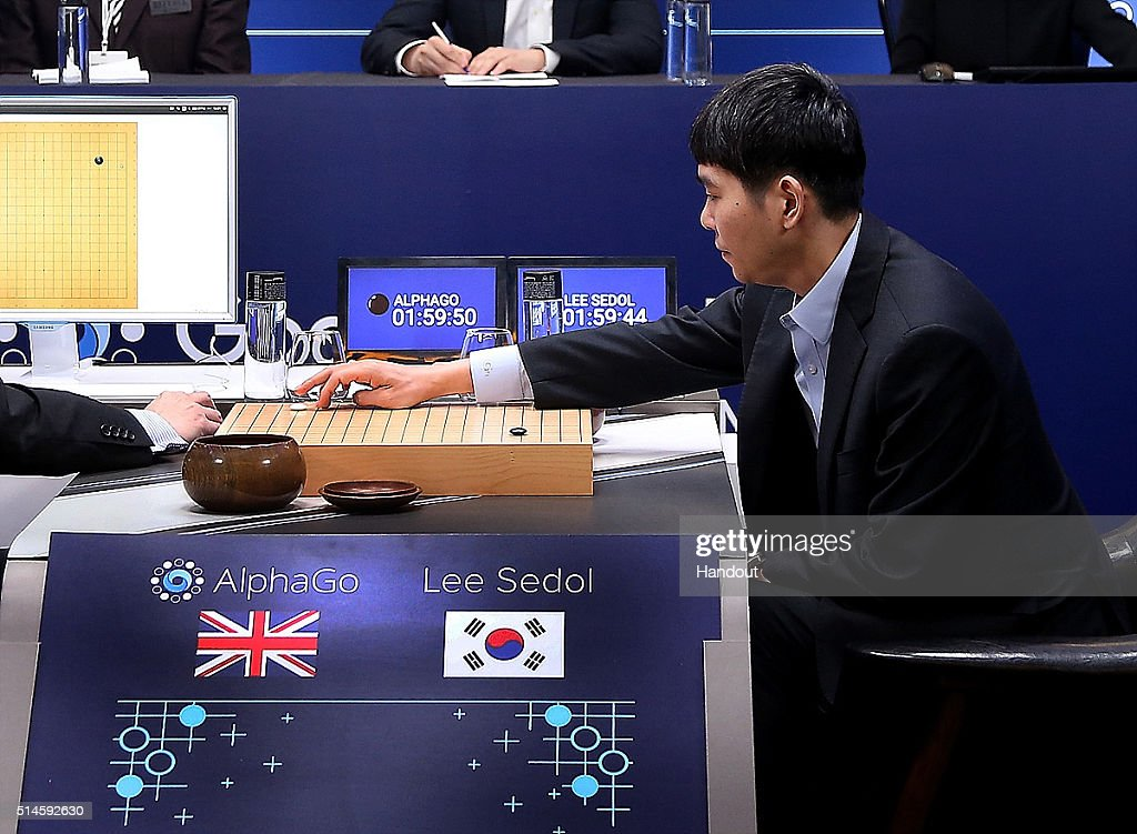 In this handout image provided by Google, South Korean professional Go player Lee Se-Dol puts his first stone against Google's artificial intelligence program, AlphaGo, during the Google DeepMind Challenge Match on March 10, 2016 in Seoul, South Korea. Lee Se-dol is playing a five-match series against a computer program developed by a Google, AlphaGo.