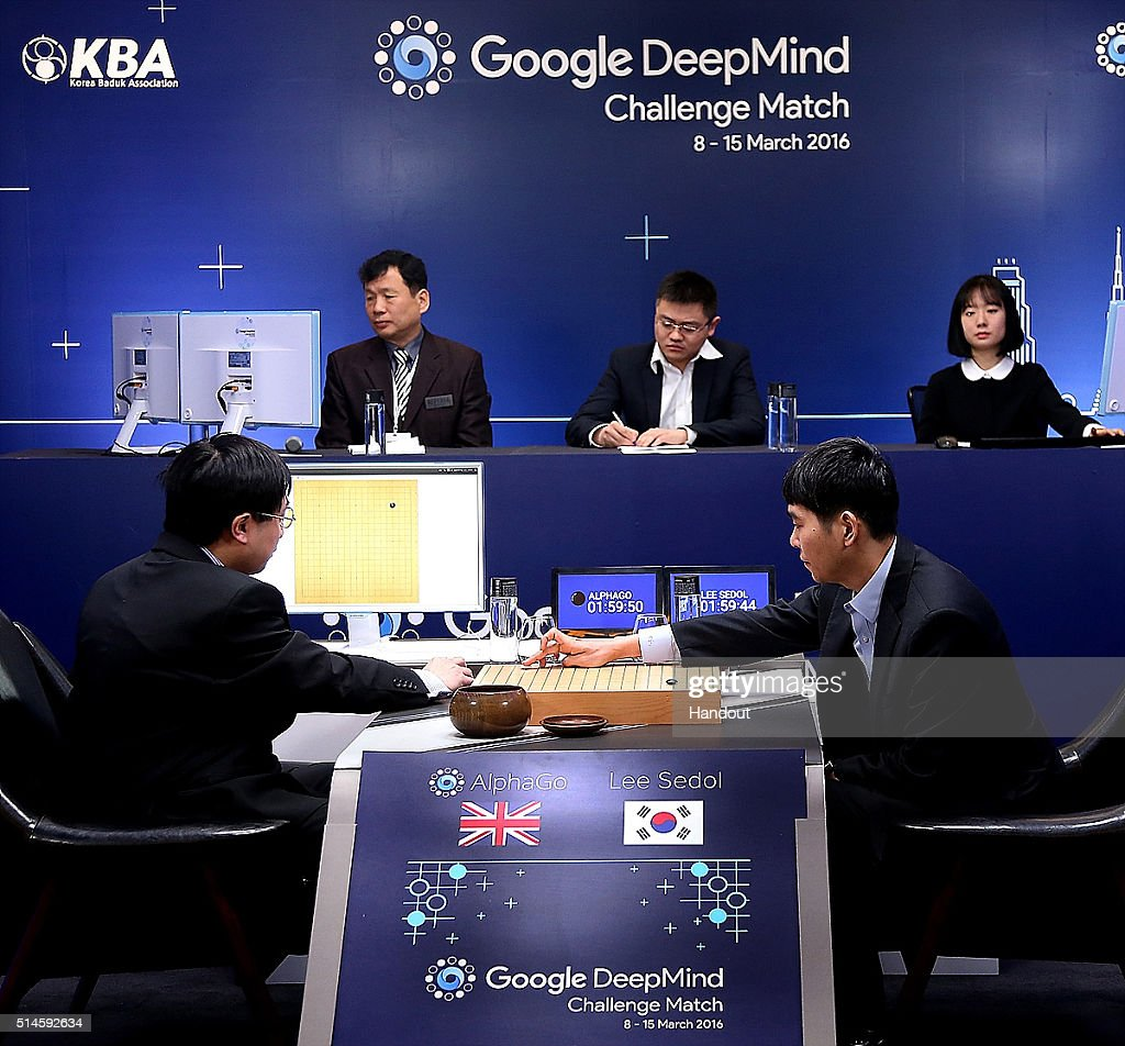 In this handout image provided by Google, South Korean professional Go player Lee Se-Dol (R) puts his first stone against Google's artificial intelligence program, AlphaGo, during the Google DeepMind Challenge Match on March 10, 2016 in Seoul, South Korea. Lee Se-dol is playing a five-match series against a computer program developed by a Google, AlphaGo.