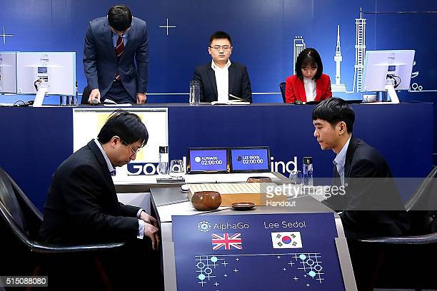 In this handout image provided by Google South Korean professional Go player Lee SeDol prepares for his third match against Google's artificial...