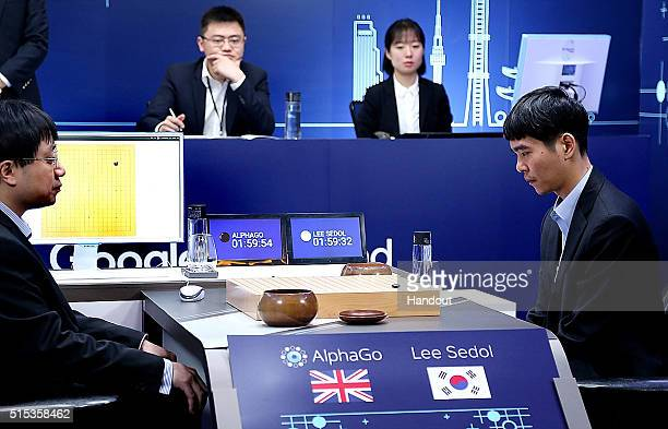 In this handout image provided by Google South Korean professional Go player Lee SeDol prepares for his fourth match against Google's artificial...
