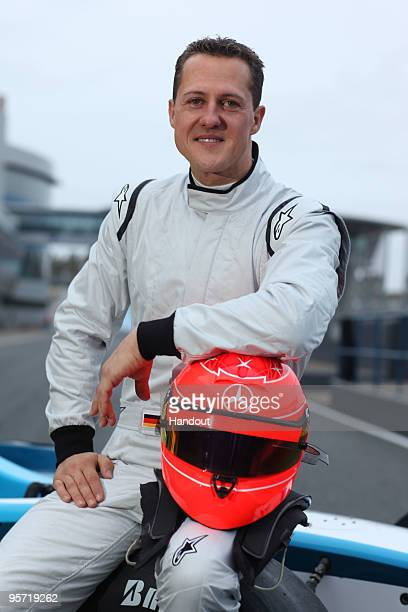 In this handout image provided by GP2 Media Michael Schumacher of Germany poses sitting on a GP2 car during testings at the Jerez circuit on January...