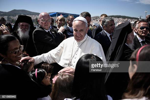 In this handout image provided by Greek Prime Minister's Office Pope Francis meets citizens and members of the catholic community on April 16 2016 in...