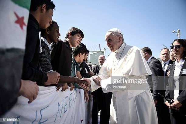 In this handout image provided by Greek Prime Minister's Office Pope Francis meets migrants at the Moria detention centre on April 16 2016 in...