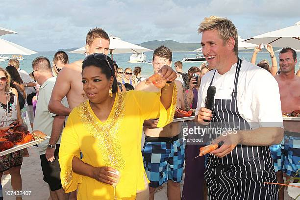 In this handout image provided by Harpo Productions Inc Oprah Winfrey poses with Chef Curtis Stone on December 8 2010 on Hamilton Island Australia...
