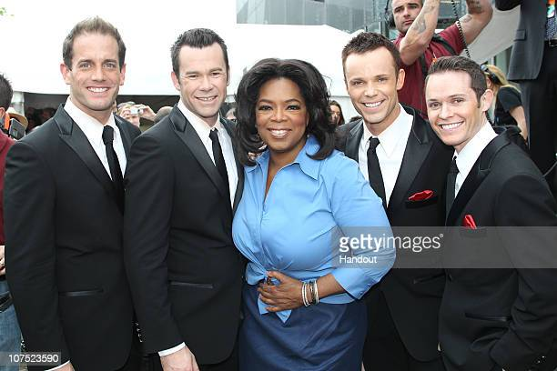 In this handout image provided by Harpo Productions Inc Oprah Winfrey poses with members of Australian band Human Nature at Federation Square on...