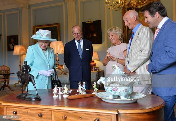 In this handout image provided by Harrison Photography Queen Elizabeth II and Prince Philip Duke of Edinburgh talk to Antiques Roadshow experts...