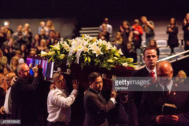 In this handout image provided by Hillsong Church Michael Chan is seen amongst the pallbearers during the funeral service for executed Bali nine...