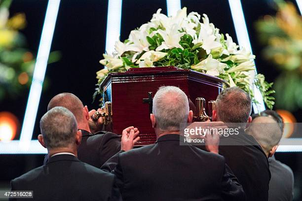 In this handout image provided by Hillsong Church pallbearers carry the coffin of Andrew Chan during his funeral service at Hillsong Church Baulkham...