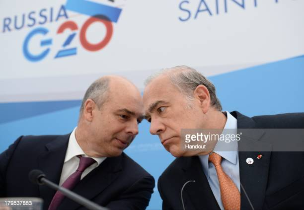 In this handout image provided by Host Photo Agency Anton Siluanov Finance Minister of the Russian Federation and Jose Angel Gurria Secretary General...