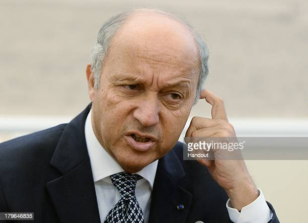 In this handout image provided by Host Photo Agency French Foreign Minister Laurent Fabius attends a meeting with Russian Foreign Minster Sergei...