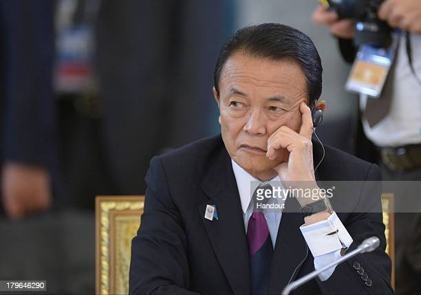 In this handout image provided by Host Photo Agency, Japanese Finance Minister Taro Aso attends the second working meeting of the G20 heads of state...