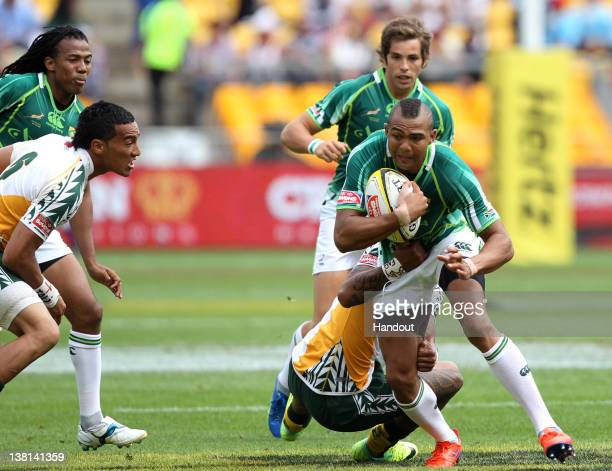 In this handout image provided by HSBC Cornal Hendricks of South Africa is tackled during the HSBC Sevens World Series match between South Africa and...