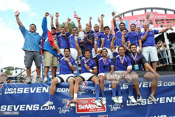 LAS VEGAS NV FEBRUARY 12 In this handout image provided by HSBC Samoa with the Cup Trophy after g final between New Zealand v Samoa of round 5 of the...
