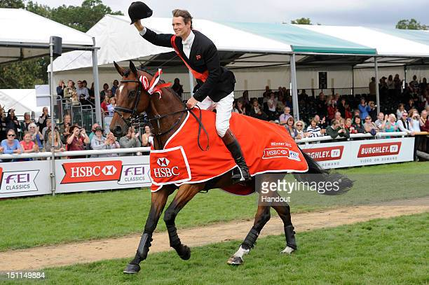 In this handout image provided by HSBC William FoxPitt of Great Britain winner of the HSBC Classics takes a lap of honour at the Land Rover Burghley...