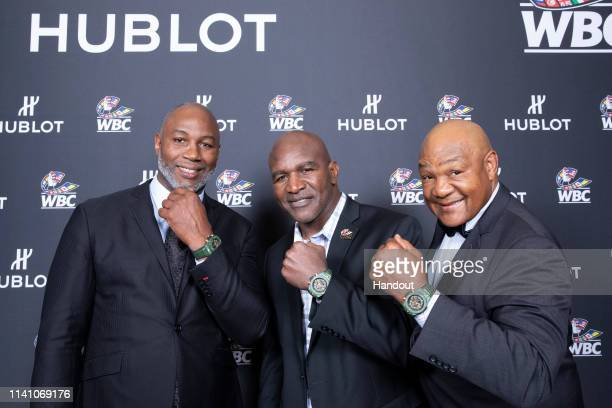 """In this handout image provided by Hublot, Lennox Lewis, Evander Holyfield and George Forman, attend the Hublot x WBC """"Night of Champions"""" Gala at the..."""