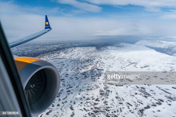In this handout image provided by Icelandair/The Brooklyn Brothers Celebratory flight 'Iceland by Air' flies over the highlands in North Iceland as...
