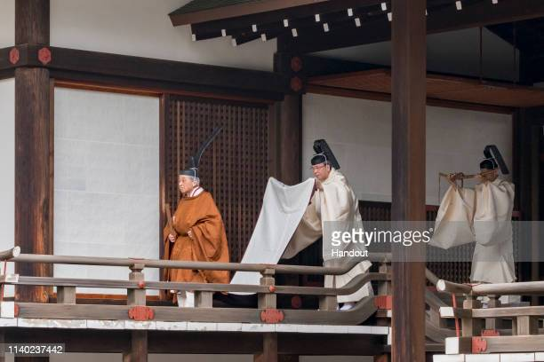 In this handout image provided by Imperial Household Agency, Emperor Akihito is seen attending the abdication ceremony at the Imperial Palace on...