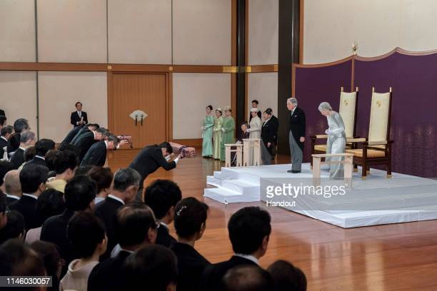 In this handout image provided by Imperial Household Agency Japanese Emperor Akihito and Empress Michiko attend the abdication ceremony at the...