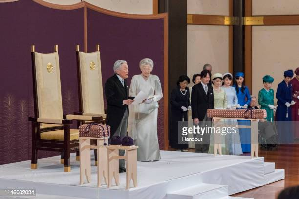 In this handout image provided by Imperial Household Agency, Japanese Emperor Akihito and Empress Michiko attend the abdication ceremony at the...