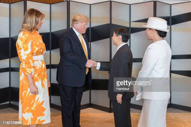 In this handout image provided by Imperial Household Agency, Japanese Emperor Naruhito, U.S. President Donald Trump, Empress Masako and first lady...