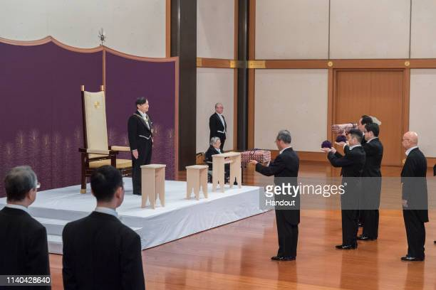 In this handout image provided by Imperial Household Agency New Japanese Emperor Naruhito inherits the imperial regalia of sword jewel and mirror...