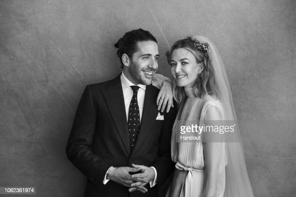 In this handout image provided by Inditex Carlos Torretta and Marta Ortega pose before their civil wedding on November 16 2018 in A Coruna Spain PAID