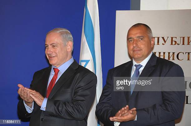 In this handout image provided by Israeli Government Press Office Israel's Prime Minister Benjamin Netanyahu attends a press conference with...