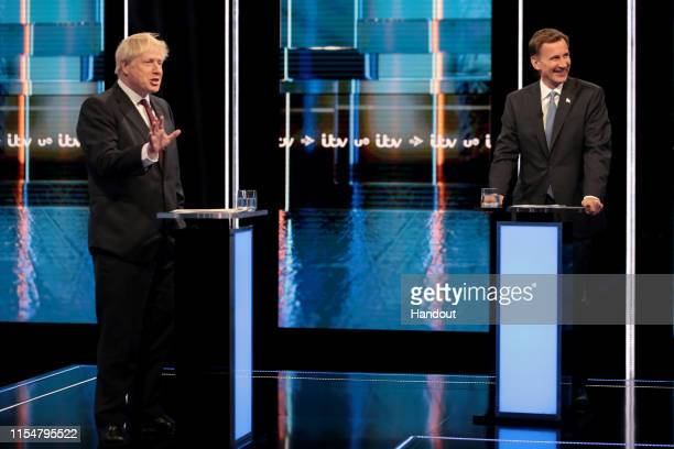 In this handout image provided by ITV Boris Johnson and Jeremy Hunt take part during the Jeremy Hunt and Boris Johnson debate Head To Head on ITV on...