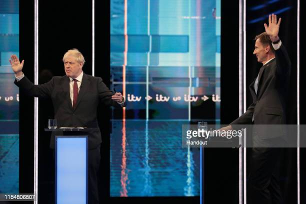 In this handout image provided by ITV, Boris Johnson and Jeremy Hunt take part in the Jeremy Hunt and Boris Johnson debate Head To Head on ITV on...