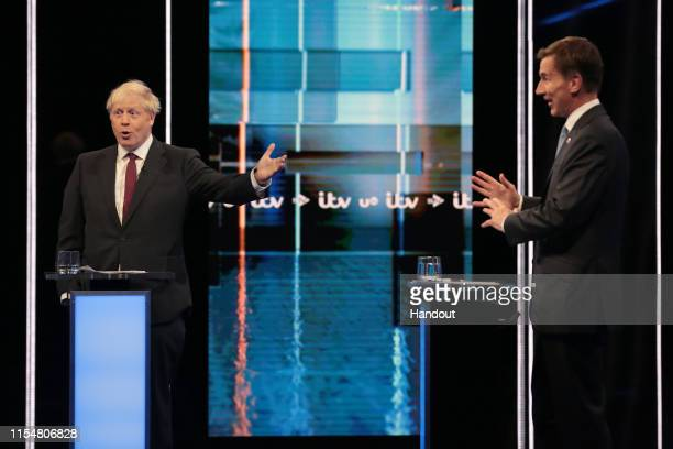 In this handout image provided by ITV Boris Johnson and Jeremy Hunt take part in the Jeremy Hunt and Boris Johnson debate Head To Head on ITV on July...