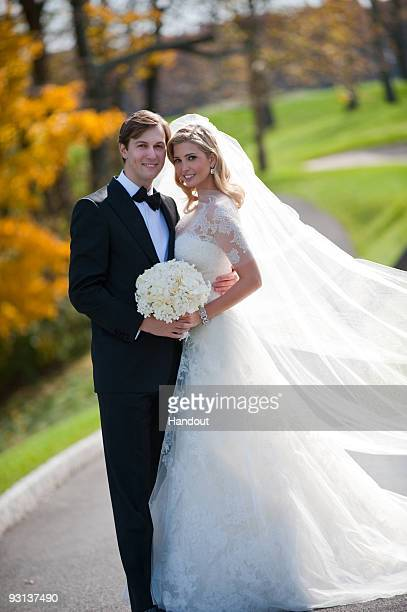 In this handout image provided by Ivanka Trump and Jared Kushner, Ivanka Trump and Jared Kushner attend their wedding at Trump National Golf Club on...