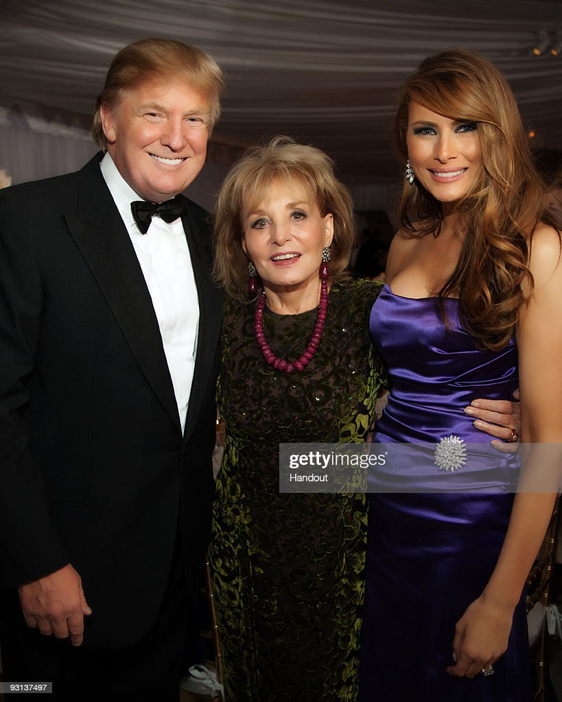 In this handout image provided by Ivanka Trump and Jared Kushner, (L-R) Donald Trump, Barbara Walters and Melania Trump attend the Ivanka Trump and Jared Kushner wedding at Trump National Golf Club on October 25, 2009 in Bedminster, New Jersey.