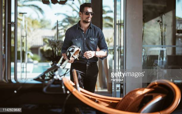 In this handout image provided by Jaguar, British model David Gandy is seen with a Jaguar XK120 before driving from St Tropez to Monaco along with a...