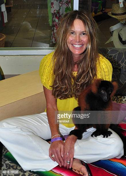 In this handout image provided by Jungle Island Elle Macpherson Australian businesswoman television host model and actress interacted with a variety...