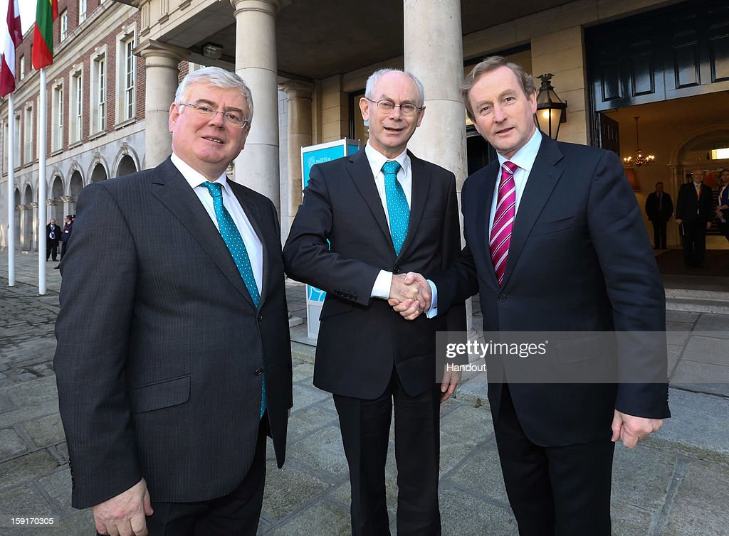 In this handout image provided by Justin MacInnes, Herman Van Rompuy (C), President of the European Council with Tanaiste Eamon Gilmore (left) and Taoiseach Enda Kenny (right) in Dublin Castle on January 9, 2013 during the European Council President's visit to Dublin, Ireland.