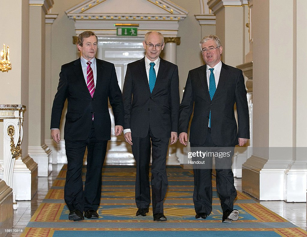 In this handout image provided by Justin MacInnes, Herman Van Rompuy (C), President of the European Council with Taoiseach Enda Kenny (left) and Tanaiste Eamon Gilmore (right) in Dublin Castle on January 9, 2013 during the European Council President's visit to Dublin, Ireland.