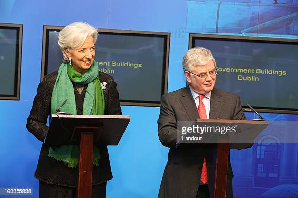 In this handout image provided by Justin MacInnes International Monetary Fund Managing Director Christine Lagarde with Tánaiste and Minister for...