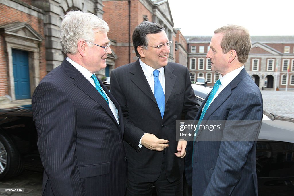 In this handout image provided by Justin MacInnes, Tánaiste Eamon Gilmore (L), Jose Manuel Barroso, President of the European Commission and Taoiseach Enda Kenny (R) at the meeting between the Irish Government and the College of Commissioners of the European Commission in Dublin Castle on January 10, 2013 in Dublin, Ireland.
