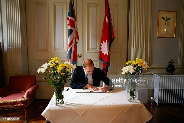 In this handout image provided by Kensington Palace Prince William Duke of Cambridge signs the Book of Condolence at the Embassy of Nepal in London...