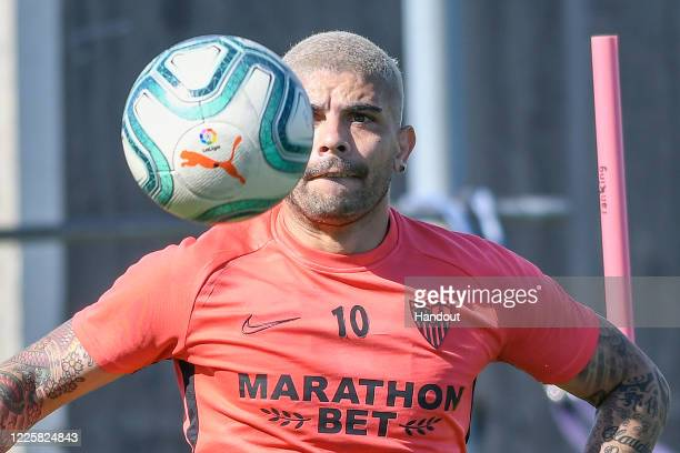 In this handout image provided by LaLiga, Ever Banega of Sevilla FC has eyes on the ball during a training session on May 19, 2020 in Seville, Spain....