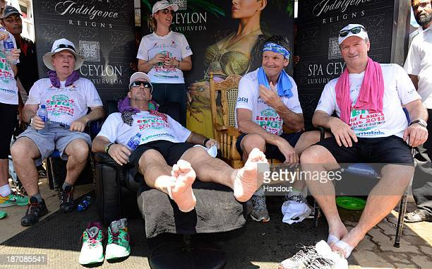 In this handout image provided by Laureus Sir Ian Botham relaxes with Allan Border Morne du Plessis and Steve Waugh after completing the sixth day of...