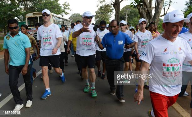 In this handout image provided by Laureus Sir Ian Botham walking on the first day of Beefy's Big Sri Lanka walk 2013 walk from Kilinochchi to...