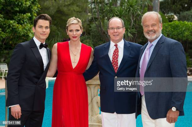 In this handout image provided by Le Palais Princier Matthew BomerPrincess Charlene of MonacoPrince Albert II of Monaco and Kelsey Grammer attend the...